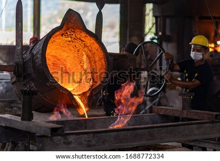 molten metal poured into the sand molding and aluminum alloy casting Royalty-Free Stock Photo #1688772334