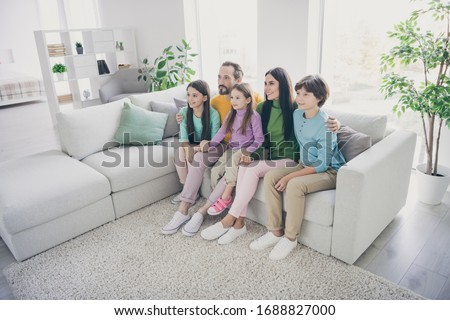 Full dream cozy loving family sit couch daddy mommy sit couch hug embrace her preteen small kids girls boys in house living room #1688827000
