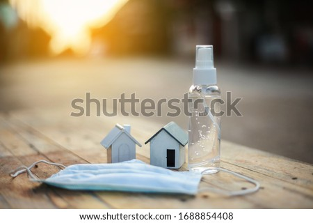 Alcohol gel and medical mask for hand cleaning to corona antivirus (covit-19), detention concept in the house #1688854408