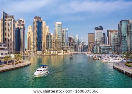 Dubai Marina skyline,yacht and famous promenade, United Arab Emirates #1688893366