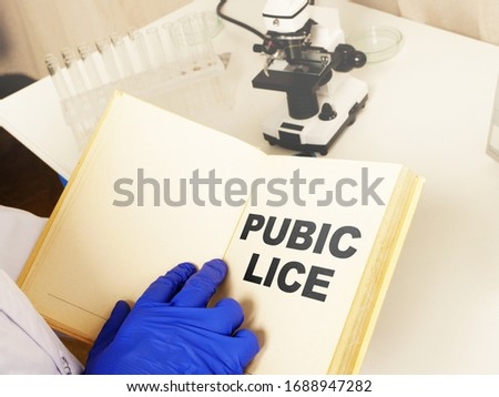 Medical photo shows hand written text Pubic lice