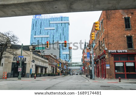 DETROIT, MI / USA - March 30, 2020: An empty street in Downtown Detroit after Michigan Governor Gretchen Whitmer ordered a stay at home due to coronavirus (COVID-19) global pandemic on March 23, 2020. #1689174481