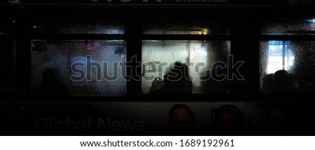 silhouettes of people through various windows of buses, restaurants etc #1689192961