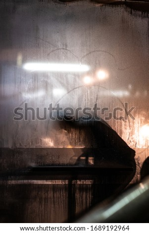 silhouettes of people through various windows of buses, restaurants etc #1689192964
