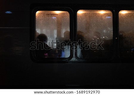 silhouettes of people through various windows of buses, restaurants etc #1689192970