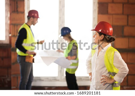 worker, investor, inspector or architect with her team. construction site engineers on site. satisfied expression #1689201181