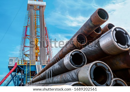 Oil and Gas Drilling Rig. Oil drilling rig operation on the oil platform in oil and gas industry. Top drive system of drilling rig. #1689202561