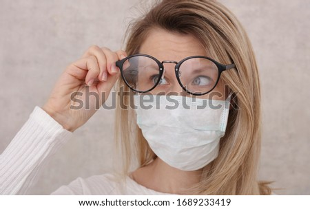 Medical mask and Glasses fogging. Avoid face touching, Coronavirus prevention, Protection. Royalty-Free Stock Photo #1689233419
