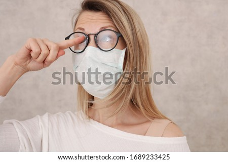 Medical mask and Glasses fogging. Avoid face touching, Coronavirus prevention, Protection. Royalty-Free Stock Photo #1689233425