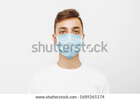 A person wearing a hygiene mask to prevent infection, airborne respiratory disease such as influenza, protection against infectious diseases, coronavirus isolated on a white background #1689265174