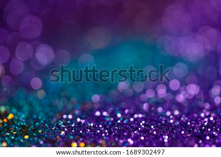 Festive twinkle lights background, abstract sparkle backdrop with circles,modern design wallpaper with sparkling glimmers. Blue, purple and green backdrop glittering sparks with glow effect Royalty-Free Stock Photo #1689302497