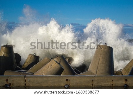 Concrete breakwater at the coast of Baltic sea, protection for the shore structure against high waves Royalty-Free Stock Photo #1689338677