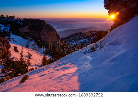 Aerial Landscape view from Ceahlău Mountains National Park at sunrise with fog in the winter season,sunrise in Ceahlau Mountains #1689392752