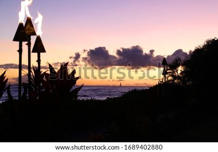 Ocean Front Tiki Torches at Dusk in Kauai Hawaii