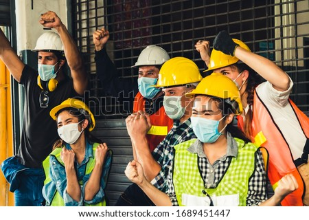 Factory workers with high morale to fight the outbreak of Novel Corona Virus Disease 2019 or COVID-19 . #1689451447
