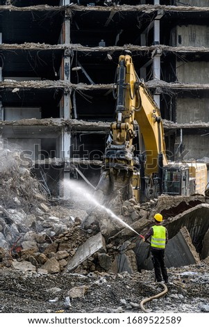 Building House destruction Demolition site Excavator with hydraulic crusher machine ruin house Royalty-Free Stock Photo #1689522589