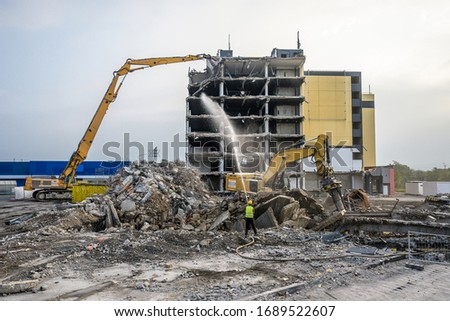 Building House destruction Demolition site Excavator with hydraulic crusher machine ruin house Royalty-Free Stock Photo #1689522607