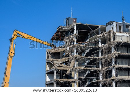 Building House destruction Demolition site Excavator with hydraulic crusher machine ruin house Royalty-Free Stock Photo #1689522613