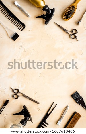 Beauty saloon concept. Hairdresser accessories pattern on beige background top-down frame copy space Royalty-Free Stock Photo #1689618466
