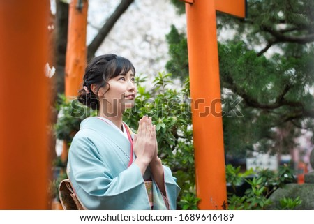 Young asian woman wearing kimono. Prayer in shrine. Japanese traditional clothes. Royalty-Free Stock Photo #1689646489