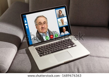 Close-up Of Businessman Video Conferencing On Laptop At Desk In Office #1689676363