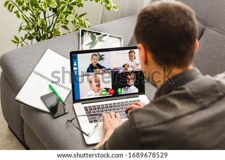Cropped image of cheerful blogger having funny conversation with best friend in video chat on modern touchpad connecting to wireless 4G internet.Young man sharing impressions of trip on webcam #1689678529