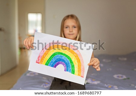 Kid painting rainbow during Covid-19 quarantine at home. Stay at home Social media campaign for coronavirus prevention, let's all be well, hope during coronavirus pandemic concept #1689680797