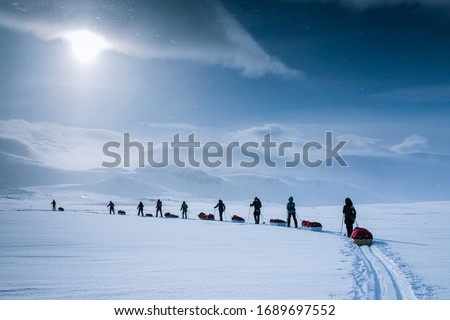 Polar expedition in Finse, Norway. Cross-country skiing across the Hardangervidda.   Royalty-Free Stock Photo #1689697552