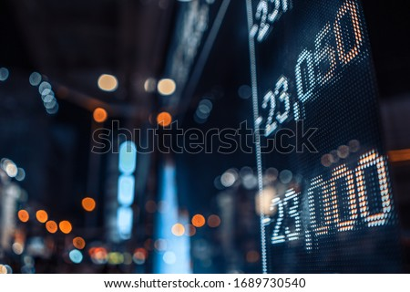 Display stock market numbers with defocused street lights background #1689730540