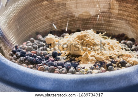 Gin botanicals in distillation flask within heating mantle Royalty-Free Stock Photo #1689734917