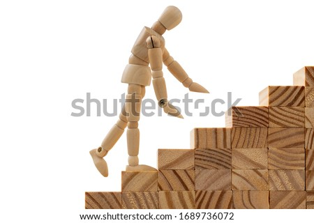 Dummy on wooden stairs going up. Personal development, personal and career growth, progress and potential concepts. #1689736072