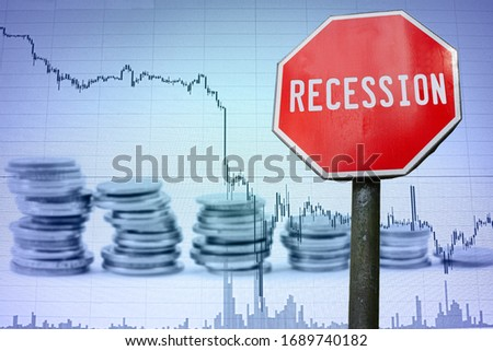 Recession sign on economy background - graph and coins. Financial crash in world economy because of coronavirus. Global economic crisis, recession. Corona virus pandemic, COVID-19 outbreak. Royalty-Free Stock Photo #1689740182