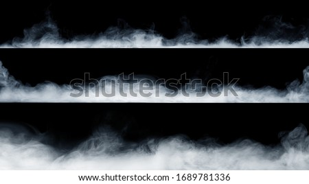 Panoramic view of the abstract fog or smoke move on black background. White cloudiness, mist or smog background.  Royalty-Free Stock Photo #1689781336