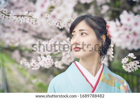 Young asian woman wearing kimono. Cherry blossoms. Japanese traditional clothes. Royalty-Free Stock Photo #1689788482