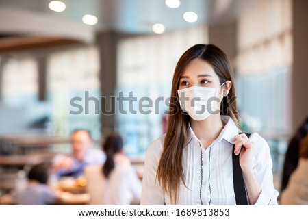 Asian woman with surgical mask face protection walking in crowds at restaurant or shopping mall #1689813853