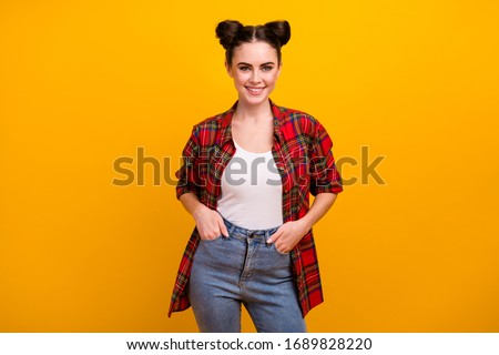 Photo of pretty brunette student lady teenager two cute funny buns good mood beaming teeth smile wear casual plaid shirt jeans isolated vibrant yellow color background #1689828220