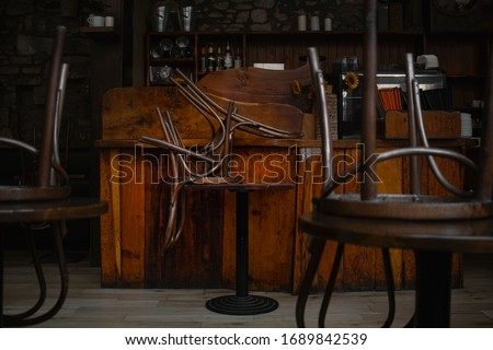 The empty interior of a closed vintage pub on the Royal Mile in Edinburgh during 2020's COVID-19 pandemic. #1689842539