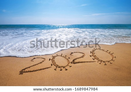 Year 2020  Global COVID-19 pandemic concept image. Sandy tropical ocean beach lettering. SARS-CoV-2 beating and vaccine researching concept image. #1689847984