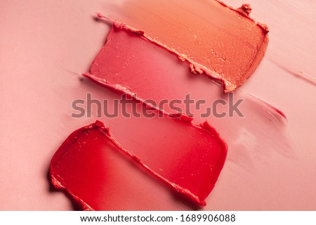 Lipstick geometric abstract lip balm strokes background texture smudged Royalty-Free Stock Photo #1689906088