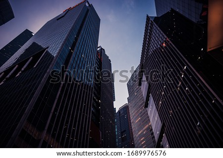 Night cityscape with city skyscrapers buildings silhouettes against blue sky of Singapore Asian financial center in perspective view  Royalty-Free Stock Photo #1689976576