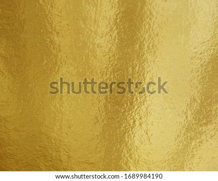 Gold foil texture background with uneven surface #1689984190