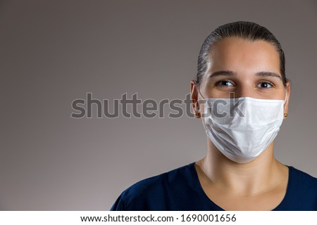 Nurse smiling and wearing facial mask #1690001656