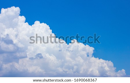 In sunny summer, huge clouds float on the blue sky. #1690068367