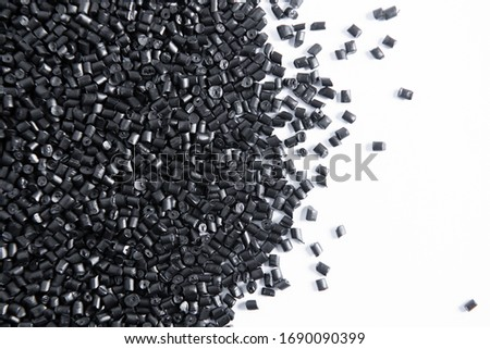 Polypropylene granule close-up background texture. plastic resin ( Masterbatch).Grey chemical granules for industrial plastic production Royalty-Free Stock Photo #1690090399