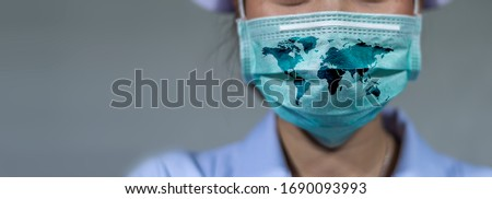 Virus Protection Covid 19 The world wears a mask to fight the corona virus. The concept of fighting viruses around the world Royalty-Free Stock Photo #1690093993