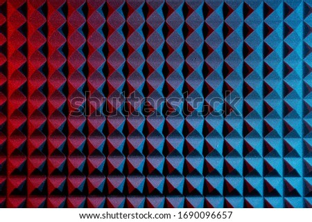 Acoustic foam panel background with red and blue lighting. Music background