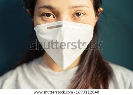 New normal woman is wearing mask for protection virus corona or covid-19  #1690112848