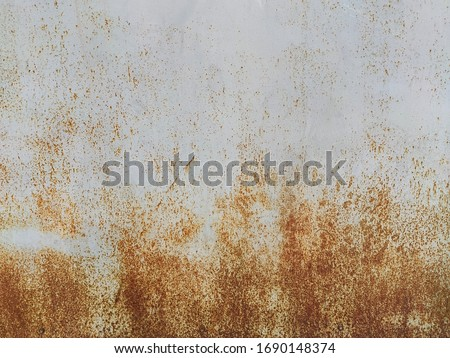 Corroded metal background. Rusty metal background with streaks of rust. Rust stains. Rystycorrosion. #1690148374