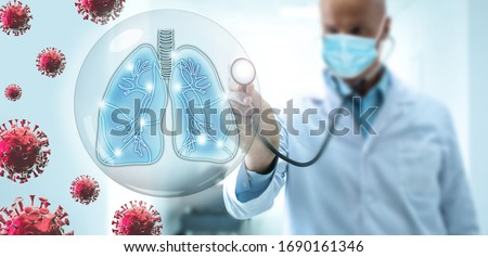 Doctor pulmonologist take care of the human lungs against the backdrop of flying COVID-19 viruses. Pneumonia caused by a complication from coronavirus. Diagnosis of the treatment of pneumonia. Royalty-Free Stock Photo #1690161346