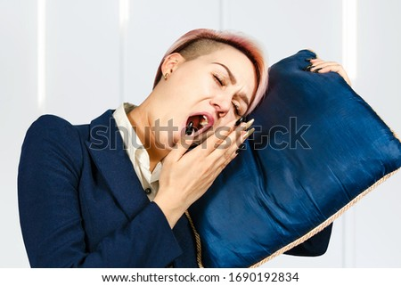 Young sleeping girl office worker lies on a pillow and yawn. #1690192834